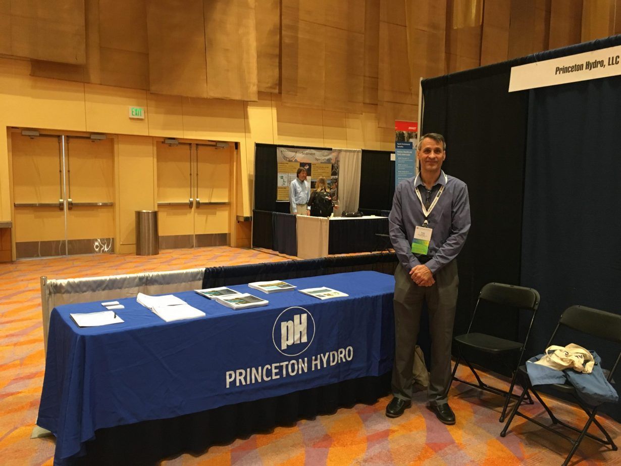 Dr. Fred Lubnow, Princeton Hydro's Director of Aquatic Programs, in the exhibitor booth at the 2018 NALMS Symposium held in Cincinnati, OH