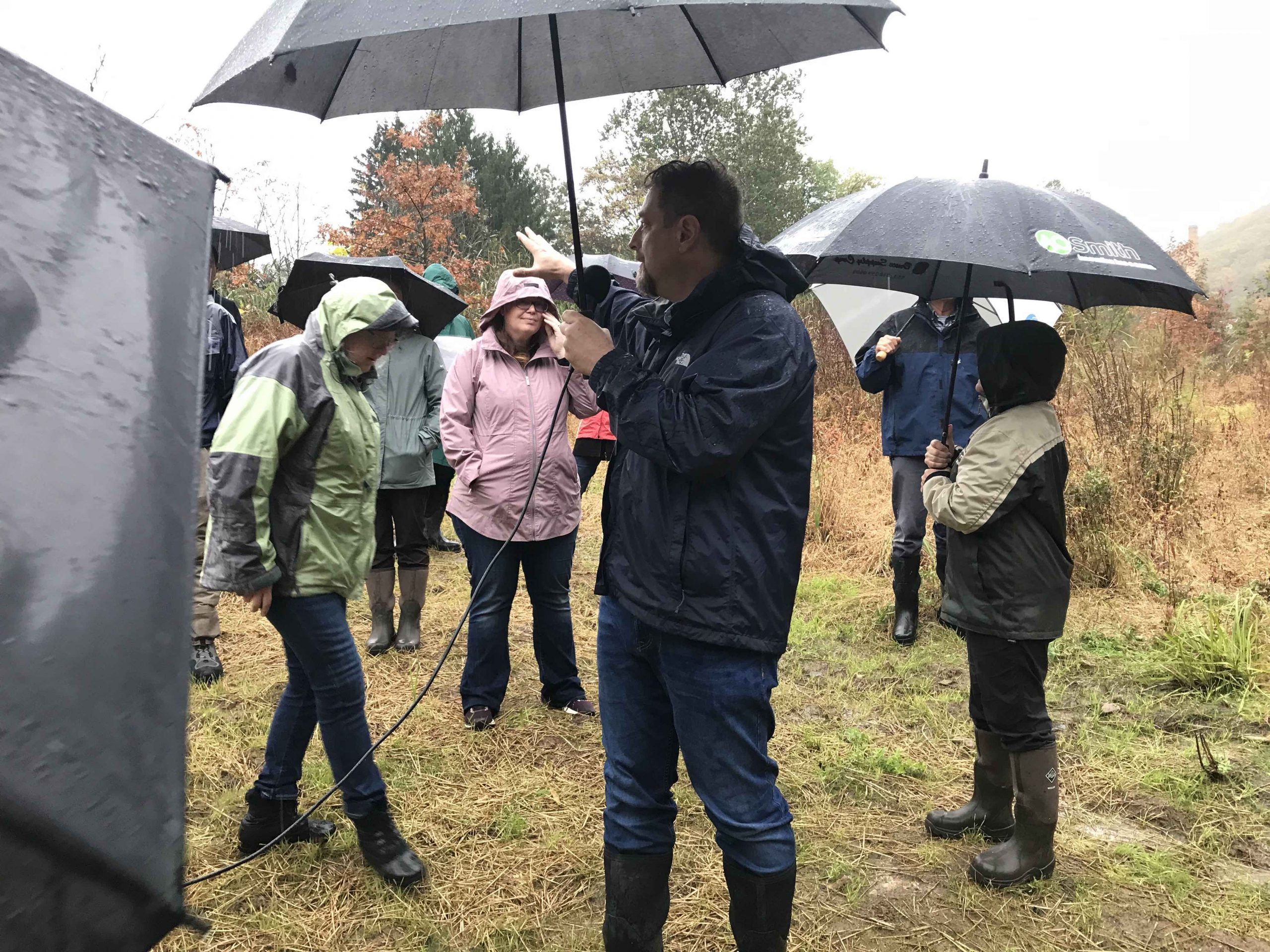 Princeton Hydro President Geoff Goll, P.E. provides field trip participants with information about the Hughesville Dam removal project and the adaptive management work currently happening at the site.