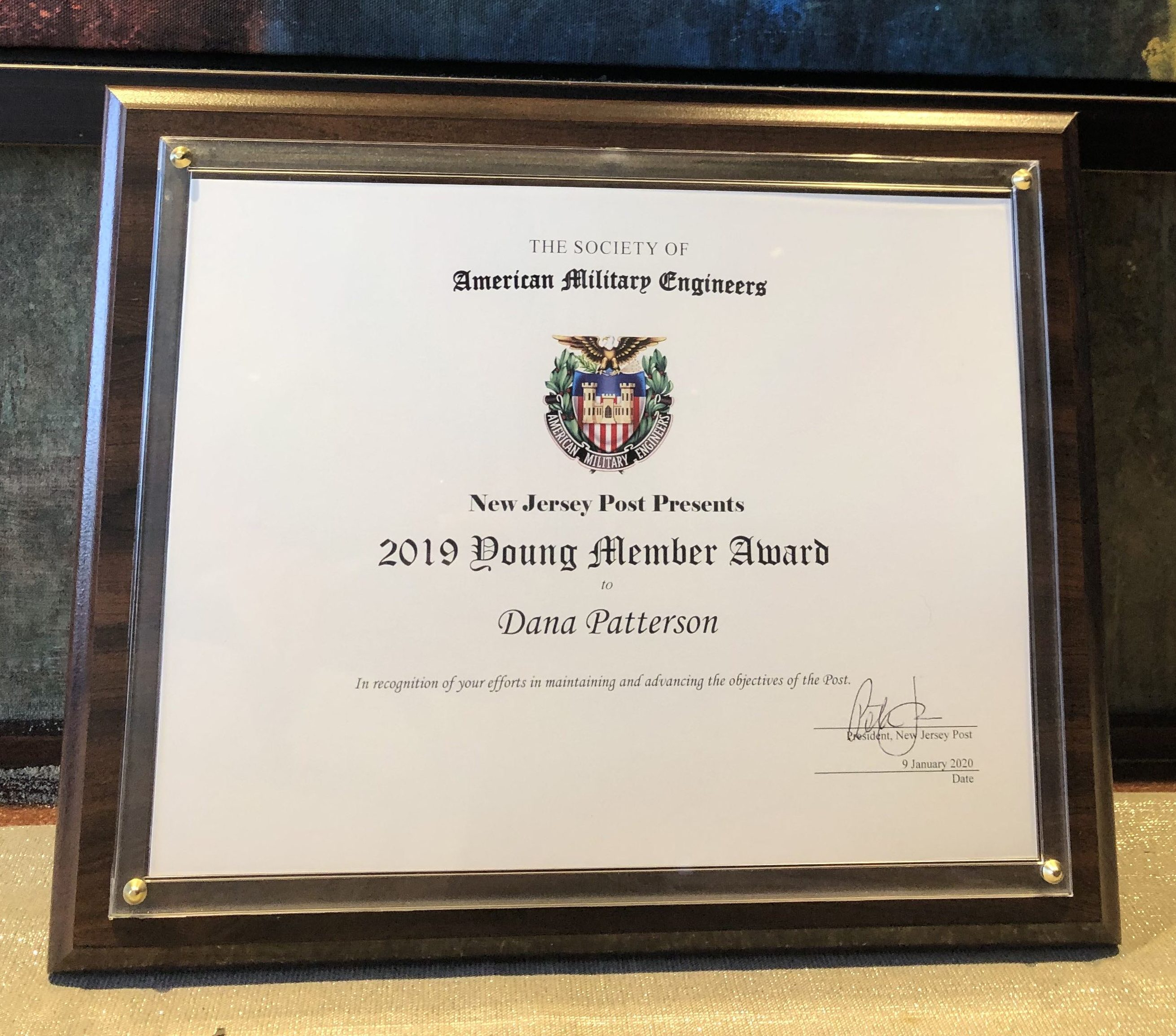 """Marketing and Communications Manager Dana Patterson was presented with the Society of American Military Engineers (SAME) New Jersey Post's """"Young Member Award"""" for her efforts in maintaining and advancing the objectives of the organization."""